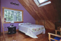 Bowerbank Maine Vacation Rental Chalet Style House On Sebec Lake, master bed, on Sebec in Maine - Vacation Rental - Home for rent on LakeHouseVacations.com