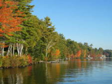 Lake House Sunrise Retreat, picturesque fall colors in October, on Long Lake in Maine - Lakehouse Vacation Rental - Lake Home for rent on LakeHouseVacations.com