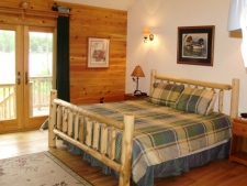 Lake House Maine Lakefront Luxury! , Master BR with King bed, whirlpool in master bath, and lakefront patio., on Branch Lake in Maine - Lakehouse Vacation Rental - Lake Home for rent on LakeHouseVacations.com