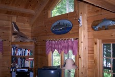 Lake House Luxurious Lakeside Retreat , Living Room with had carved local fish and birds., on Cold Stream Pond in Maine - Lakehouse Vacation Rental - Lake Home for rent on LakeHouseVacations.com