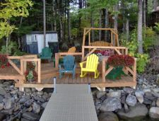 Lake House Luxurious Lakeside Retreat , The deck and aluminum dock allows you to take advanatge of the water., on Cold Stream Pond in Maine - Lakehouse Vacation Rental - Lake Home for rent on LakeHouseVacations.com