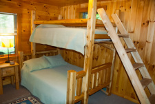Lake House Log House Maine Lake Shore Boats Fishing Swim Spa, Garden level bedroom; artisan-made bunk with full & twin size beds.  Large room, lake view., on Sand Pond in Maine - Lakehouse Vacation Rental - Lake Home for rent on LakeHouseVacations.com