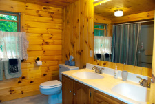 Lake House Log House Maine Lake Shore Boats Fishing Swim Spa, Large bathroom with tub/shower on upper level.  Two bedrooms on this level., on Sand Pond in Maine - Lakehouse Vacation Rental - Lake Home for rent on LakeHouseVacations.com