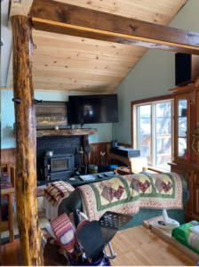 Lake House Lakeside Year Round Rustic Elegance, Cedar post & beam add charm;TV WIFI and Surround sound adds luxury to cozy LR, on Hedges Lake in New York - Lakehouse Vacation Rental - Lake Home for rent on LakeHouseVacations.com