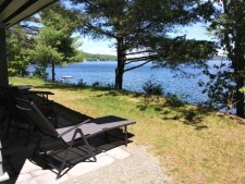 Lake House Camp On Swan Lake , Backyard , on Swan Lake in Maine - Lakehouse Vacation Rental - Lake Home for rent on LakeHouseVacations.com