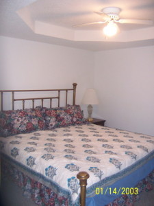 Lake House Lakefront Rental House Tennessee River, Scottsboro, Guntersville, We have different comforters now, old pic of King room, on Lake Guntersville in Alabama - Lakehouse Vacation Rental - Lake Home for rent on LakeHouseVacations.com