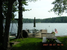 Lake House Lake Carey Waterfront Furnished Rental House In Tunkhannock, Lakefront with picnic table, swing, and chairs., on Lake Carey in Pennsylvania - Lakehouse Vacation Rental - Lake Home for rent on LakeHouseVacations.com