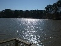 Lake House Relax And Enjoy Lake Sinclair In This Amazing 4br 3bath Rental With 250' Lake Front, View of Lake at Dusk from Dock, on Lake Sinclair in Georgia - Lakehouse Vacation Rental - Lake Home for rent on LakeHouseVacations.com