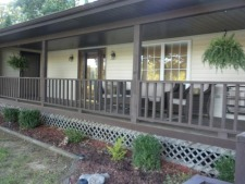 Lake House A Newly Updated 4 Bedroom 3 Bath Lake Home With Panoramic View!! New Boatdock!!!!!!!, Porch off living room overlooking the lake, on Lake Sara in Illinois - Lakehouse Vacation Rental - Lake Home for rent on LakeHouseVacations.com