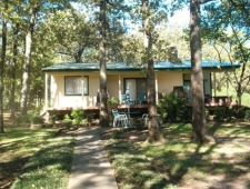 Lake House Cottage On The Lake, Lakefront Cottage Rental, Walkway from porch to lake & marina, on Lake Tawakoni in Texas - Lakehouse Vacation Rental - Lake Home for rent on LakeHouseVacations.com