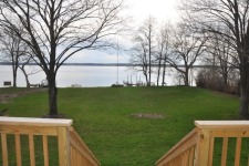 Lake House Level Lake Front East Side , Level front yard between house and lake., on Cayuga Lake in New York - Lakehouse Vacation Rental - Lake Home for rent on LakeHouseVacations.com