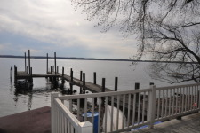Lake House Level Lake Front East Side , Large Stone beach.  U shaped dock., on Cayuga Lake in New York - Lakehouse Vacation Rental - Lake Home for rent on LakeHouseVacations.com
