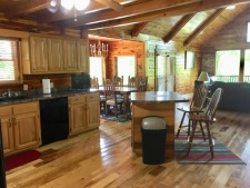 Lake House New Cedar Log Home On Lake Barkley With Deep Water Dock, view of kitchen coming in the door, on Lake Barkley in Kentucky - Lakehouse Vacation Rental - Lake Home for rent on LakeHouseVacations.com