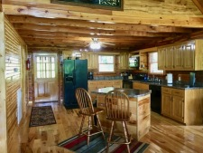Lake House New Cedar Log Home On Lake Barkley With Deep Water Dock, view of kitchen from living room, on Lake Barkley in Kentucky - Lakehouse Vacation Rental - Lake Home for rent on LakeHouseVacations.com