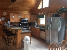 Lake House Maine Lakefront Luxury! , Enjoy a modern kitchen with SS appliances/ granite countertops. , on Branch Lake in Maine - Lakehouse Vacation Rental - Lake Home for rent on LakeHouseVacations.com