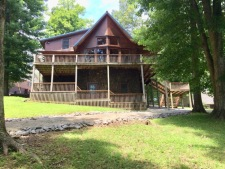 Lake House New Cedar Log Home On Lake Barkley With Deep Water Dock, view of house from lake, on Lake Barkley in Kentucky - Lakehouse Vacation Rental - Lake Home for rent on LakeHouseVacations.com
