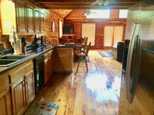 Lake House One Of A Kind Cedar Log Home, kitchen walking in from mudroom, on Lake Barkley in Kentucky - Lakehouse Vacation Rental - Lake Home for rent on LakeHouseVacations.com