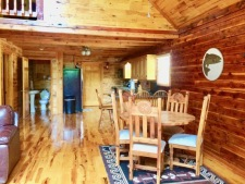 Lake House One Of A Kind Cedar Log Home, dining room and kitchen, on Lake Barkley in Kentucky - Lakehouse Vacation Rental - Lake Home for rent on LakeHouseVacations.com