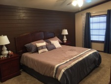 Lake House Floating Home With Private Boat Slip, Master bedroom with king size bed, on Lake Texoma in Texas - Lakehouse Vacation Rental - Lake Home for rent on LakeHouseVacations.com