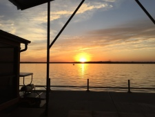 Lake House Floating Home With Private Boat Slip, Sunset from private covered deck, on Lake Texoma in Texas - Lakehouse Vacation Rental - Lake Home for rent on LakeHouseVacations.com