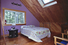Lake House Bowerbank Maine Vacation Rental Chalet Style House On Sebec Lake, master bed, on Sebec Lake in Maine - Lakehouse Vacation Rental - Lake Home for rent on LakeHouseVacations.com