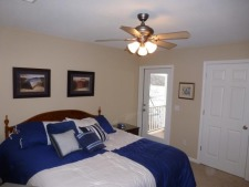 Lake House Perfect Family Vacation, Lower Bedroom with deck access - King Bed, on Lake of the Ozarks in Missouri - Lakehouse Vacation Rental - Lake Home for rent on LakeHouseVacations.com