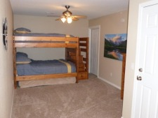 Lake House Perfect Family Vacation, Lower Bedroom Bunks have full size mattresses and twin trundle - also with deck access, on Lake of the Ozarks in Missouri - Lakehouse Vacation Rental - Lake Home for rent on LakeHouseVacations.com