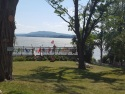Lake House Lake Champlain Modern Cottages! Rent 1, 2 Or All 3! Perfect For Couples/large Groups!, The event deck overlooking the lake and Adirondack mountains , on Lake Champlain in Vermont - Lakehouse Vacation Rental - Lake Home for rent on LakeHouseVacations.com